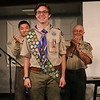 SHEILA SELMAN | THE GOSHEN NEWS<br /> Wyatt Hart poses proudly in front of his audience at LifeSpring Church in Goshen Sunday after being conferred the title of Eagle Scout. Behind him are his mentor Benjamin Rogers, left, and assistant scout master Curt Bartow.