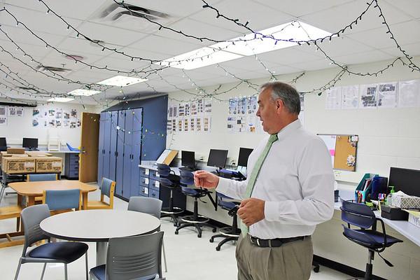 CAMDEN CHAFFEE | THE GOSHEN NEWS<br /> Fairfield superintendent Robert Evans stands in the new school newpaper and journalism room at Fairfield High School Wednesday.