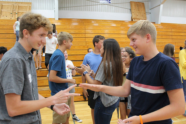 CAMDEN CHAFFEE | THE GOSHEN NEWS<br /> Jacob Shank and Jacob Leininger engage in a rock, paper, scissors contest during the all school social at Bethany Christian Schools on the first day Tuesday.
