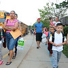 AIMEE AMBROSE | THE GOSHEN NEWS <br /> Students and families walk into Concord West Side Elementary School as buses line up to drop off children for the first day of Concord Community Schools' 2019-20 year Wednesday.