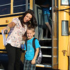 CAMDEN CHAFFEE | THE GOSHEN NEWS<br /> New Paris Elementary School Principal Megan Gingerich helps students find out where they need to go Wednesday on their first day back to school.