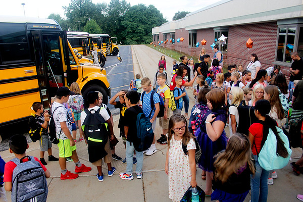 JOHN KLINE | THE GOSHEN NEWS<br /> Students congregate at the front entrance of Jefferson Elementary School after arriving for the first day of the new school year for Middlebury Community Schools early Wednesday morning.