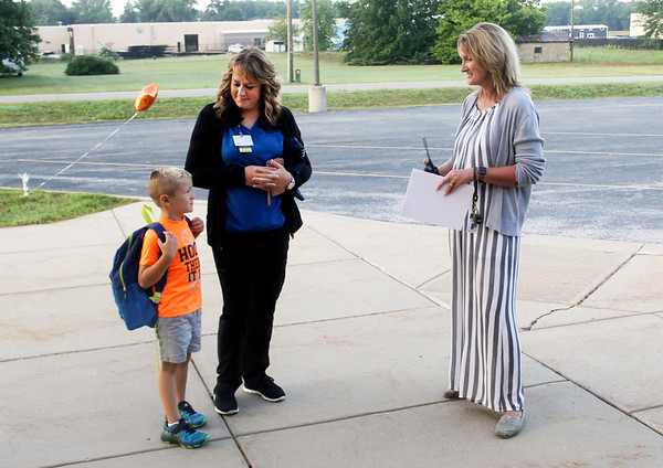 JOHN KLINE | THE GOSHEN NEWS<br /> Tricia Brickner, principal of Jefferson Elementary School, right, chats with Bristol resident Jennifer Diller, center, and her son, Dawson Diller, 5, during the first day of the new school year for Middlebury Community Schools early Wednesday morning.