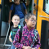 AIMEE AMBROSE | THE GOSHEN NEWS <br /> Students exit their bus and head to Concord West Side Elementary School for the first day of classes in the new school year Wednesday.