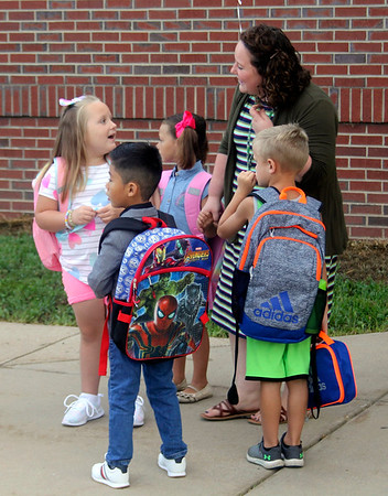 JOHN KLINE | THE GOSHEN NEWS<br /> Liz Hren, a kindergarten teacher at Jefferson Elementary School, upper right, chats with students during the first day of the new school year for Middlebury Community Schools early Wednesday morning.