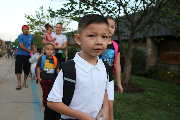 AIMEE AMBROSE | THE GOSHEN NEWS <br /> Jaime Alvarez, a 1st grader, walks with  other students and families into Concord West Side Elementary School for the first day of the new school year Wednesday.