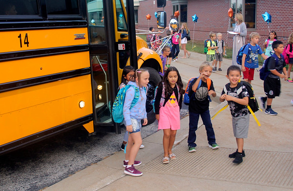 JOHN KLINE | THE GOSHEN NEWS<br /> Students exit their bus after arriving at Jefferson Elementary School early Wednesday morning for the first day of the new school year for Middlebury Community Schools.