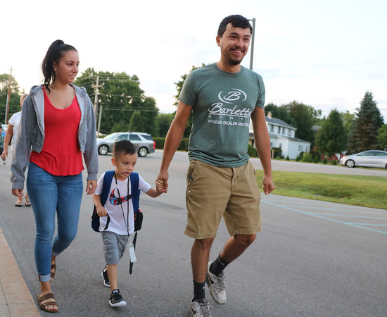 AIMEE AMBROSE | THE GOSHEN NEWS <br /> A family walks a boy into Concord West Side Elementary School for the first day of classes in the new school year Wednesday.