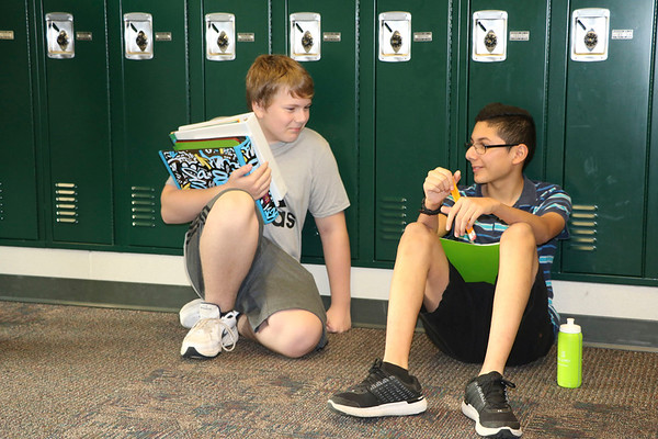 AIMEE AMBROSE | THE GOSHEN NEWS <br /> (from left) Seventh graders Dillon Hankins, Elkhart, and Diego Sosa, Elkhart, hang out in front of lockers before classes begin at Concord Jr. High School on the first day of Concord Community Schools' 2019-20 school year Wednesday.
