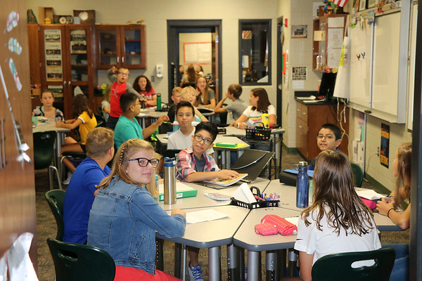 AIMEE AMBROSE   THE GOSHEN NEWS <br /> Students gather at tables in Jennifer Higley's seventh grade science class at Concord Jr. High School as the first day of the 2019-20 school year begins Wednesday.