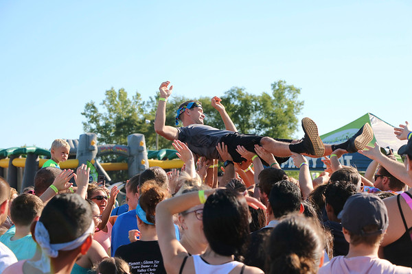 AIMEE AMBROSE   THE GOSHEN NEWS <br /> A man crowd surfs as part of the entertainment while participants wait for their wave to start the obstacle course of the Great Inflatable Race at the Elkhart County Fairgrounds Saturday.