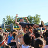 AIMEE AMBROSE | THE GOSHEN NEWS <br /> A man crowd surfs as part of the entertainment while participants wait for their wave to start the obstacle course of the Great Inflatable Race at the Elkhart County Fairgrounds Saturday.