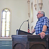 CAMDEN CHAFFEE | THE GOSHEN NEWS <br /> The Rev. Alan Griffin stands Tuesday in the pulpit at the First Presbyterian Church where he preaches every Sunday morning.