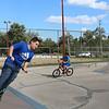 Sheila Selman   The Goshen News<br /> <br /> Matthew Schultz, 13, Goshen, slides across a ramp at the Tyler Joldersma Memorial Skate Park in Goshen Wednesday afternoon.