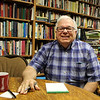 CAMDEN CHAFFEE | THE GOSHEN NEWS <br /> The Rev. Alan Griffin sits in his office Tuesday in front of the library of books he has collected in his many years as a Presbyterian minister.