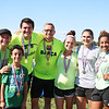 AIMEE AMBROSE | THE GOSHEN NEWS <br /> (from left) Grace Anderson, Brayden Liddell, Brayden Weaver, Paul Anderson, Joy Weaver, Amelia Serafino and Karen Liddell wear medals after completing the Great Inflatable Race and its course of about 10 bouncy obstacles at the Elkhart County Fairgrounds Saturday.