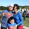 AIMEE AMBROSE | THE GOSHEN NEWS <br /> A family wearing Superman t-shirts and a cape poses after completing the first obstacle during the Great Inflatable Race at the Elkhart County Fairgrounds Saturday.