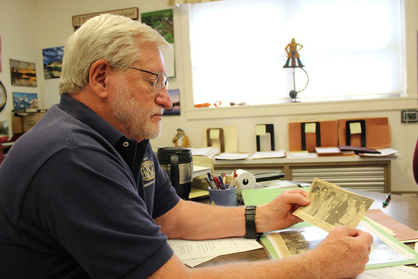 CAMDEN CHAFFEE | THE GOSHEN NEWS<br /> Founding Goshen Noon Kiwanis Club member Jon Brookmyer reminisces about his time in the club through old documents and newspaper articles.