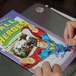 Clay Sidenbender | The Gsohen News<br /> Allen Stewart autographs a Hall of Heroes comic book that was created to tell visitors about the Elkhart museum.