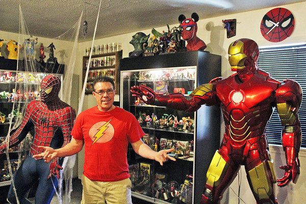 Clay Sidenbender| The Goshen News<br /> Allen Stewart, founder of the Superhero Hall of Fame Museum, stands with displays of Iron Man and Spiderman memorabelia.