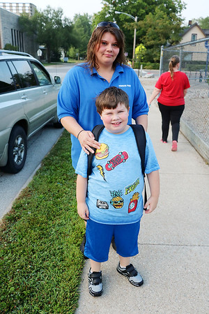 JOHN KLINE | THE GOSHEN NEWS<br /> Cindi Delacruz drops off second grader Peyton Bussard, 7, at Chandler Elementary School early Wednesday morning during the first day of school for Goshen Community Schools.