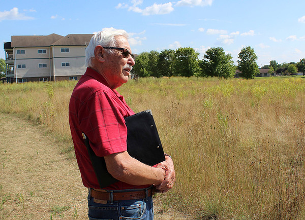 CAMDEN CHAFFEE | THE GOSHEN NEWS<br /> Don Yoder stands in one of the trails in the Greencroft Goshen prairie Wednesday and admires what he has helped to create.