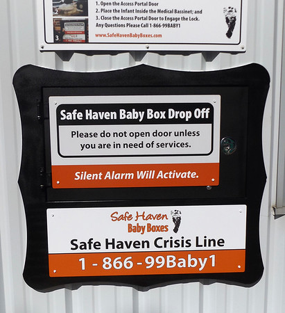 Denise Fedorow | The Goshen News<br /> The sign on the Safe Haven Box just put into operation at Turkey Creek Fires Station #2 gives instructions plus a 24-hour hotline number for women to contact for additional help and counseling. The footprint on the sign belongs to Baby Amelia, a baby found abandoned and dead at Eagle Park in Indianapolis in December of 2014. This is the 11th active box in Indiana.