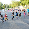 JOHN KLINE | THE GOSHEN NEWS<br /> Katie Wingard, a first grade teacher at Chandler Elementary School, left, leads her class of new first-graders into the school building during the first day of the new school year for Goshen Community Schools  Wednesday morning.