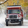 Goshen street department snow removal continues on E. Douglas Road Tuesday after a record snowfall for Elkhart County of 13 inches fell between Monday night and Tuesday morning. The previous record for Nov.11-12 of 3 1/2 inches was set back in 1959.