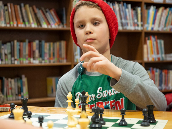 Joseph Weiser   The Goshen News<br /> <br /> Waterford Elementary fifth-grader Landon Hall, 10, of Elkhart, prepares to makes his move in a game of chess during a chess club meeting Tuesday at the Goshen school.