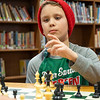 Joseph Weiser | The Goshen News<br /> <br /> Waterford Elementary fifth-grader Landon Hall, 10, of Elkhart, prepares to makes his move in a game of chess during a chess club meeting Tuesday at the Goshen school.