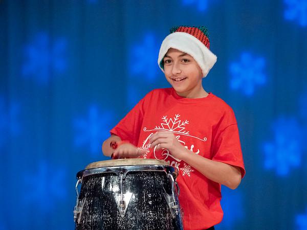 "Hugo Lopez-Macias, 14, of Goshen, performs ""Little Drummer Boy"" with his classmates during the Goshen Middle School Hip Hop Christmas Concert Tuesday evening."