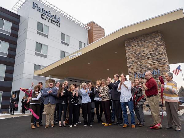 Joseph Weiser | The Goshen News<br /> <br /> Fairfield Inn & Suites General Manager Jennifer Brown, of Goshen, cuts the ribbon during the Fairfield Inn & Suites grand opening Monday.
