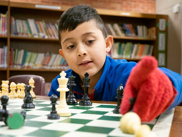 Joseph Weiser | The Goshen News<br /> <br /> Waterford Elementary second-grader Angel Herrera, 8, of Goshen, makes his move in a game of chess during a chess club meeting Tuesday at the Goshen school.