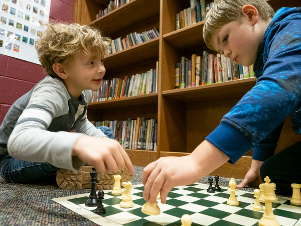 Joseph Weiser   The Goshen News<br /> <br /> Waterford Elementary second-grader Brayden Barkman, 7, of Goshen, left, shows Waterford Elementary second-grader Luke Valderrana, 8, of Goshen, where he can move in a game of chess during a chess club meeting Tuesday at the Goshen school.
