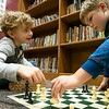 Joseph Weiser | The Goshen News<br /> <br /> Waterford Elementary second-grader Brayden Barkman, 7, of Goshen, left, shows Waterford Elementary second-grader Luke Valderrana, 8, of Goshen, where he can move in a game of chess during a chess club meeting Tuesday at the Goshen school.