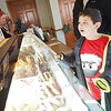 Jack Dorlin, 9, of Bristol, orders a sweet treat Tuesday at Dutch Maid Bakery, 508 W. Lincoln Ave., Goshen. The bakery offered a 10 percent discount on purchases to patrons donning ugly Christmas sweaters Tuesday.