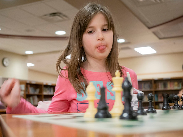 Joseph Weiser | The Goshen News<br /> <br /> Waterford Elementary second-grader Mckayla Adair, 7, of Goshen, reacts after she makes her move in a game of chess during a chess club meeting Tuesday at the Goshen school.