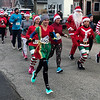 John Kline | The Goshen News<br /> Runners decked in holiday garb take to the streets for the annual Santa Run and Stroll fundraiser at the St. Mary of the Annunciation Catholic Church in Bristol Saturday morning.