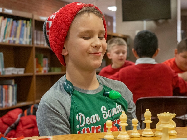 Joseph Weiser | The Goshen News<br /> <br /> Waterford Elementary fifth-grader Landon Hall, 10, of Elkhart, reacts after he makes his move in a game of chess during a chess club meeting Tuesday at the Goshen school.