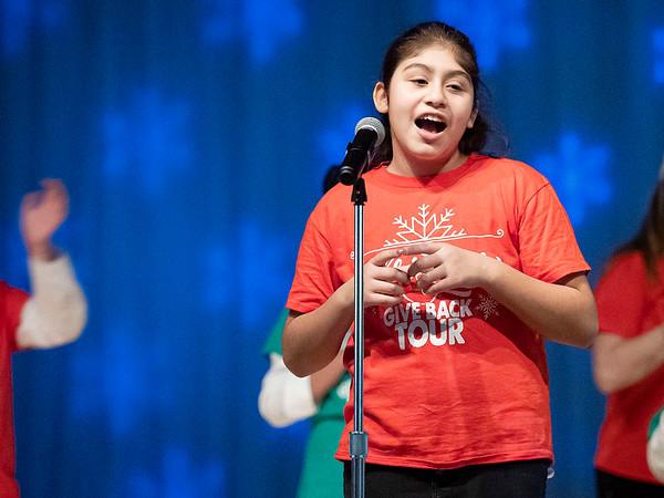 "Yadira Flores, 11, of Goshen, sings ""Feliz Navidad"" with her classmates during the Goshen Middle School Hip Hop Christmas Concert Tuesday evening."