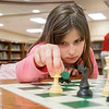 Joseph Weiser | The Goshen News<br /> <br /> Waterford Elementary second-grader Mckayla Adair, 7, of Goshen, makes her move in a game of chess during a chess club meeting Tuesday at the Goshen school.