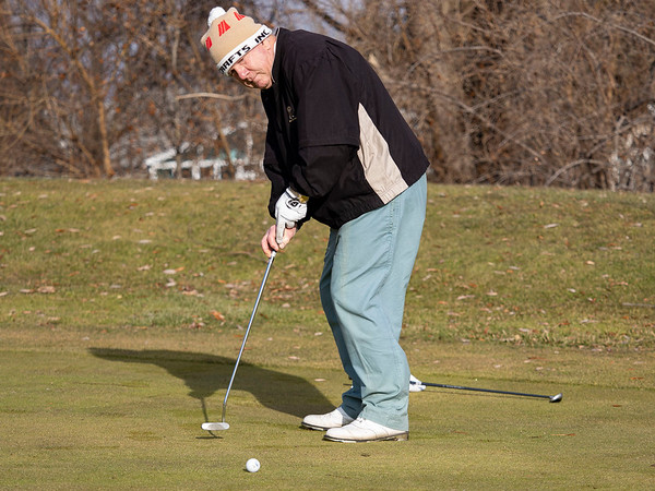 Tony Boros, of Pierceton, attempts a putt at Black Squirrel Golf Club at 1017 Larimer Dr. Goshen, during a record breaking high of 63 degrees Thursday. The previous record high of 56 degrees was set on December 26, 2016.