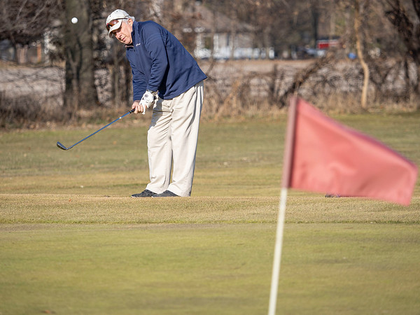Wayne Daniel, of Elkhart, chips the ball onto the green at Black Squirrel Golf Club at 1017 Larimer Dr. Goshen, during a record breaking high of 63 degrees Thursday. The previous record high of 56 degrees was set on December 26, 2016.