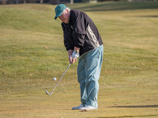 Tony Boros, of Pierceton, chips the ball onto the green at Black Squirrel Golf Club at 1017 Larimer Dr. Goshen, during a record breaking high of 63 degrees Thursday. The previous record high of 56 degrees was set on December 26, 2016.