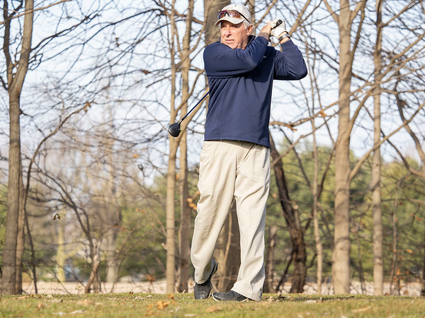 Wayne Daniel, of Elkhart, drives the ball off the tee at Black Squirrel Golf Club at 1017 Larimer Dr. Goshen,  during a record breaking high of 63 degrees Thursday. The previous record high of 56 degrees was set on December 26, 2016.