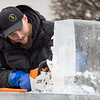 """Ice sculpture Josh Niven, of Buchanan, Michigan, carves out a portion of the """"Magical Reindeer, inspired by the spirit of the holidays"""" ice sculpture during the first day of the Shipshewana Ice Festival Friday. The """"Magical Reindeer"""" is the largest ice sculpture ever done in Shipshewana in front of the Blue Gate Restaurant located at 195 N. Van Buren St., in Shipshewana."""