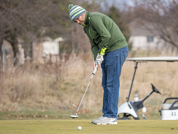 Andy Kern, of South Bend, putts the ball into first hole at Black Squirrel Golf Club at 1017 Larimer Dr. Goshen, during a record breaking high of 63 degrees Thursday. The previous record high of 56 degrees was set on December 26, 2016.
