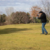 TJ Roberts, of Galien, Michigan, drives the ball off the first tee at Black Squirrel Golf Club at 1017 Larimer Dr. Goshen, during a record breaking high of 63 degrees Thursday. The previous record high of 56 degrees was set on December 26, 2016. The ball is in the upper left hand corner of the frame.