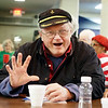 """Ron Allard, of Elkhart, reacts after winning a prize during the """"Pass the Gift"""" game during the  Elkhart County Council on Aging Christmas party at First Presbyterian Church in Elkhart Thursday."""